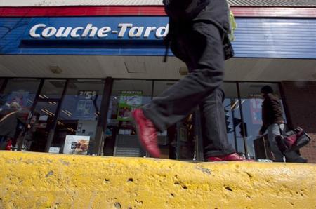 A pedestrian walks past a Couche-Tard convenience store in Montreal, April 18, 2012. REUTERS/Christinne Muschi