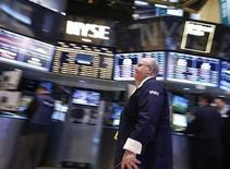 Wall Street a ouvert en hausse mardi après deux séances de baisse, surmontant les inquiétudes liées aux tensions autour de Chypre en Europe. L'indice Dow Jones gagne 0,23% après dix minutes d'échanges. Le Standard & Poor's 500 progresse de 0,21% et le Nasdaq Composite prend 0,25%. /Photo prise le 18 mars 2013/REUTERS/Brendan McDermid