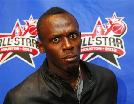 Olympic gold medal sprinter Usain Bolt arrives for the 2013 NBA All-Star basketball game in Houston, Texas, February 17, 2013. REUTERS/Jeff Haynes