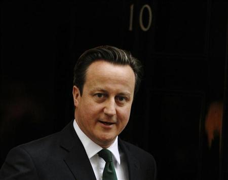 Britain's Prime Minister David Cameron leaves Number 10 Downing Street in London March 18, 2013. REUTERS/Luke MacGregor