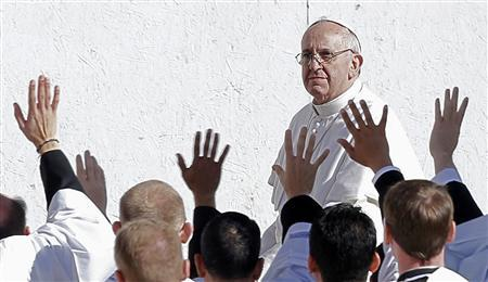 Pope Francis passes waving priests as he arrives in Saint Peter's Square for his inaugural mass at the Vatican, March 19, 2013. REUTERS/Alessandro Bianchi