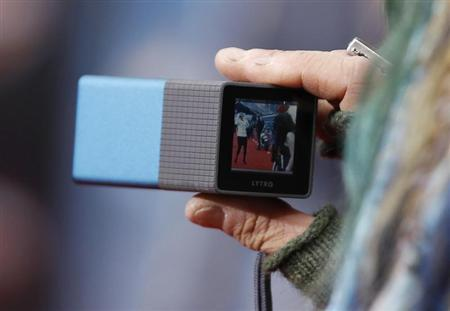 A guest uses a Lytro light field camera on the red carpet at the world premiere of the film ''Marvel's The Avengers'' in Hollywood, California April 11, 2012. REUTERS/Danny Moloshok