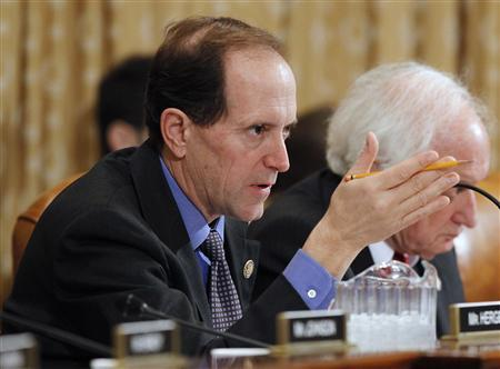 House Ways and Means Committee Chair Dave Camp (R-MI) questions U.S. Secretary of the Treasury Timothy Geithner in Washington February 15, 2012. Geithner is testifying on President Barack Obama's Fiscal Year 2013 Budget. REUTERS/ Gary Cameron
