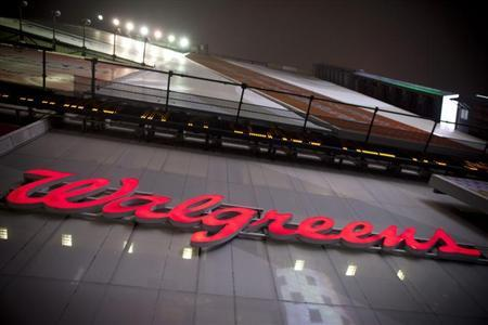 The logo of Walgreens is seen at their Times Square store in New York December 17, 2012. REUTERS/Andrew Kelly