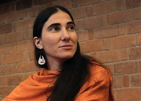 Cuba's best-known dissident blogger Yoani Sanchez listens to a question after she delivered a speech to students of the Iberoamericana University in Mexico City March 13, 2013. REUTERS/Henry Romero