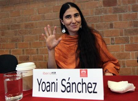 Cuba's best-known dissident blogger Yoani Sanchez waves before giving a speech to students of the Iberoamericana University in Mexico City March 13, 2013. REUTERS/Henry Romero