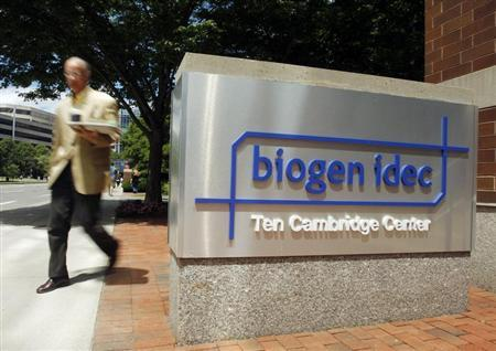A pedestrian passes the sign outside the headquarters of Biogen Idec Inc. in Cambridge, Massachusetts June 18, 2008. REUTERS/Brian Snyder