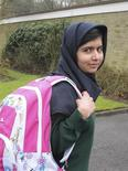 Malala Yousufzai smiles as she attends Edgbaston High School for girls in Edgbaston, central England in this handout photograph released March 19, 2013. REUTERS/Edelman/Handout