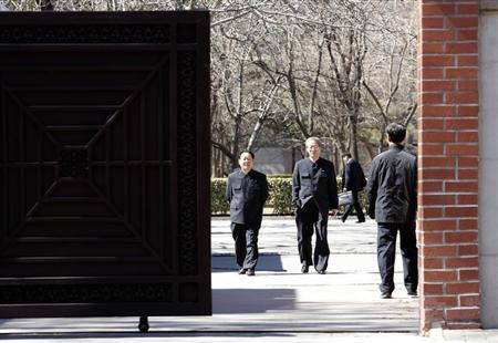 North Korean are seen through a gate at the North Korean embassy in Beijing March 18, 2013. REUTERS/Kim Kyung-Hoon