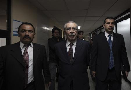 Former Guatemalan dictator Efrain Rios Montt (C) enters the Supreme Court of Justice for the first session of his trial in Guatemala City, March 19, 2013. REUTERS/William Gularte