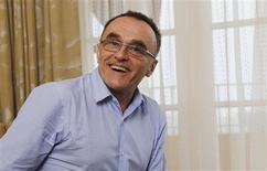 "Director Danny Boyle poses for a portrait while promoting his movie ""Trance"" in Los Angeles, California March 16, 2013. Picture taken March 16, 2013. REUTERS/Mario Anzuoni"