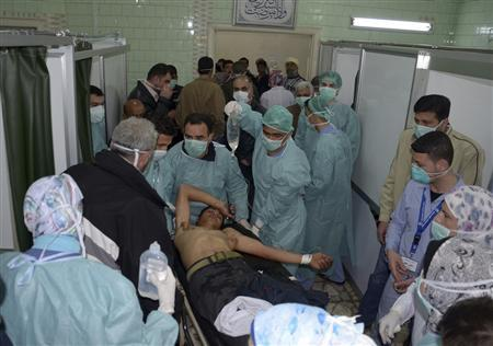 A man, wounded in what the government said was a chemical weapons attack, is treated at a hospital in the Syrian city of Aleppo March 19, 2013. REUTERS/George Ourfalian