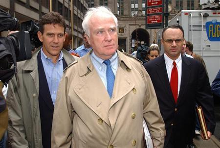 Major League Baseball's Tim Brosnan, Robert DuPuy and Rob Manfred (L-R) leave 245 Park Avenue en route to the Major League Baseball Players Union office to continue negotiations, in New York, August 29, 2002. REUTERS/Chip East