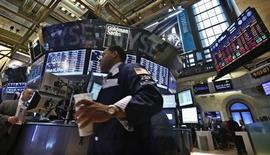 Traders work on the floor at the New York Stock Exchange, March 11, 2013. REUTERS/Brendan McDermid