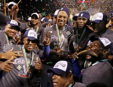 Players from the Dominican Republic, including tournament MVP Robinson Cano (C), celebrate with the trophy after they defeated Puerto Rico in the final to win the World Baseball Classic in San Francisco, March 19, 2013. REUTERS/Lucy Nicholson