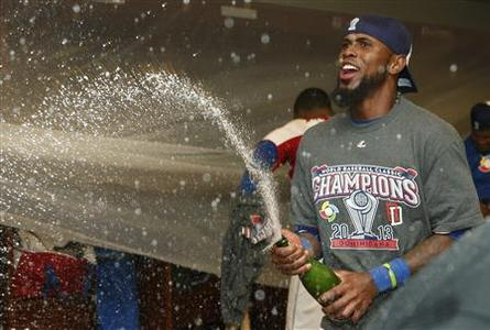 Jose Reyes of the Dominican Republic celebrates in the dressing room after his team defeated Puerto Rico in the final to win the World Baseball Classic in San Francisco, March 19, 2013. REUTERS-Stephen Lam