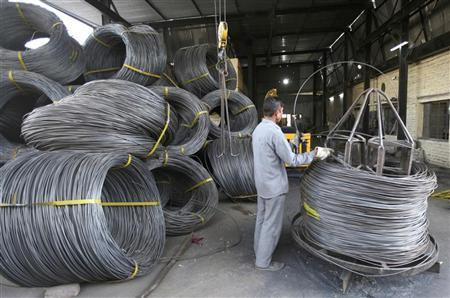 A labourer works inside an electrode factory on the outskirts of Jammu December 10, 2009. REUTERS/Mukesh Gupta/Files
