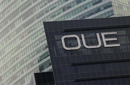The Overseas Union Enterprise (OUE) logo on its office building in Singapore October 23, 2012. REUTERS/Edgar Su