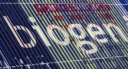 The company's name is displayed on a billboard near the headquarters of Biogen Idec Inc. in Cambridge, Massachusetts June 18, 2008. REUTERS/Brian Snyder