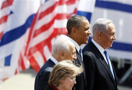U.S. President Barack Obama (C) stands with Israel's President Shimon Peres and Prime Minister Benjamin Netanyahu (R) after landing at Ben Gurion International Airport near Tel Aviv March 20, 2013. REUTERS/Darren Whiteside