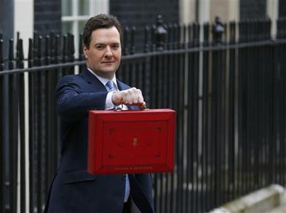 Britain's Chancellor of the Exchequer, George Osborne, holds up his budget case for the cameras as he stands outside number 11 Downing Street, before delivering his budget to the House of Commons, in central London March 20, 2013. REUTERS/Andrew Winning