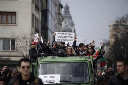 Bulgarian protesters shout slogans as they ride a truck during a rally in central Sofia, March 3, 2013. REUTERS/Stoyan Nenov