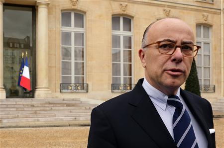 French newly-named Budget Minister Bernard Cazeneuve speaks to journalists after the weekly cabinet meeting at the Elysee Palace in Paris March 20, 2013. REUTERS/Philippe Wojazer