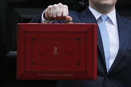 Britain's Chancellor of the Exchequer, George Osborne, holds up his budget case for the cameras as he stands outside number 11 Downing Street, before delivering his budget to the House of Commons, in central London March 20, 2013. REUTERS/Stefan Wermuth