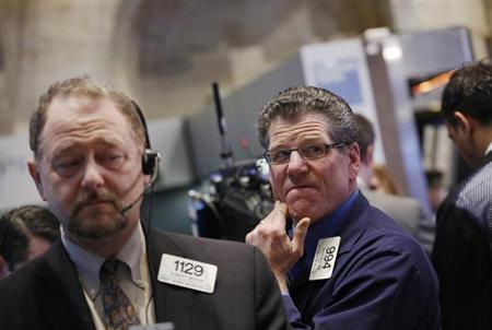 Traders work on the floor at the New York Stock Exchange, March 19, 2013. REUTERS/Brendan McDermid/Files