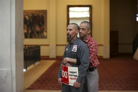 Same-sex couple Frank Capley (L) and Joe Alfano listen to a speaker at City Hall in San Francisco, California February 14, 2013. REUTERS/Robert Galbraith