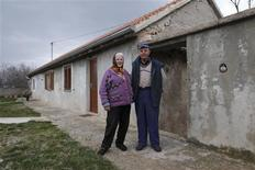 Nikola Jankovic (R), 83, poses next to his wife Dragonja in the village of Bobodol, near Knin, in central Croatia March 6, 2013. REUTERS/Antonio Bronic