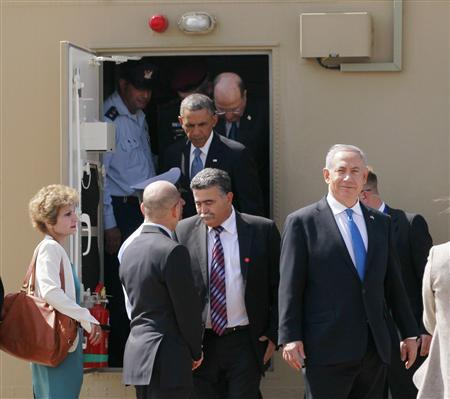 U.S. President Barack Obama (rear) steps out of an Iron Dome battery with Israeli Prime Minister Benjamin Netanyahu (R) at Ben Gurion International Airport Airport in Tel Aviv March 20, 2013. REUTERS/Jason Reed