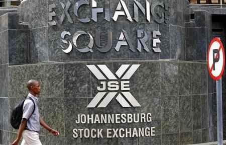 A man walks past the Johannesburg Stock Exchange building in Sandton December 6, 2012. REUTERS/Siphiwe Sibeko