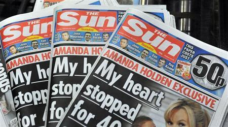 The first copies of the new Sun on Sunday newspaper to roll off the presses are seen at the News Printers, in Broxbourne, England February 25, 2012. REUTERS/John Stillwell/POOL