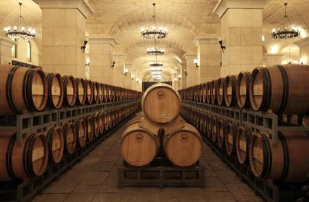 Barrels of wine are seen inside a wine cellar in Chateau Changyu Afip Global on the outskirts of Beijing, September 17, 2010. REUTERS/Barry Huang