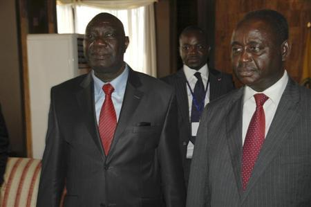 Michel Am-Nondokro Djotodia (L), leader of Central African Republic's (CAR) Seleka rebel alliance, stands beside CAR's President Francois Bozize (R) during peace talks with delegations representing the government and the opposition rebels in Libreville January 11, 2013. REUTERS/Levis Boussougou