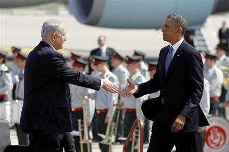 U.S. President Barack Obama (R) shakes hands with Israeli Prime Minster Benjamin Netanyahu at Ben Gurion International Airport Airport in Tel Aviv, March 20, 2013. REUTERS/Jason Reed