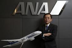 All Nippon Airways (ANA) Co's Senior Executive Vice President and next president Osamu Shinobe poses behind a model of ANA's Boeing Co's 787 Dreamliner plane and under the company logo after an interview with Reuters in Tokyo March 18, 2013. REUTERS/Toru Hanai