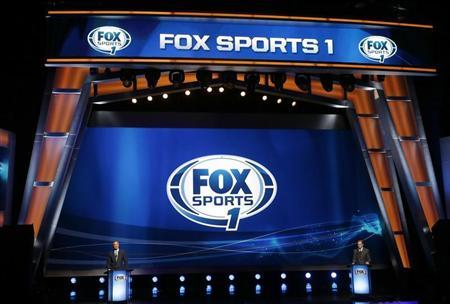 Co-Presidents and Chief Operating Officers of Fox Media Group Randy Freer (L) and Eric Shanks (R) appear during a presentation to announce Fox's new sports network ''Fox Sports 1'' in New York, March 5, 2013. REUTERS/Mike Segar
