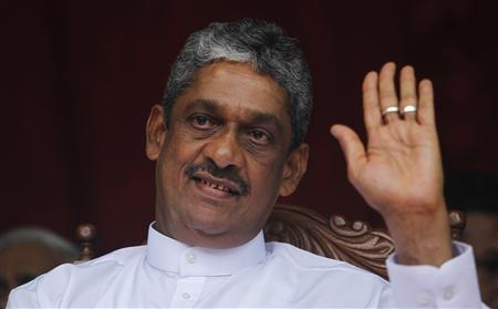 Former army chief and defeated presidential candidate Sarath Fonseka waves at his supporters during a political rally in Colombo October 18, 2012. REUTERS/Dinuka Liyanawatte