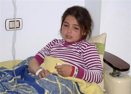 A girl, injured in what the government said was a chemical weapons attack, is treated at a hospital in the Syrian city of Aleppo March 19, 2013. REUTERS/George Ourfalian