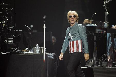 Singer Jon Bon Jovi performs with his band Bon Jovi during the 2012 iHeart Radio Music Festival at the MGM Grand Garden Arena in Las Vegas, Nevada September 21, 2012. REUTERS/Steve Marcus/Files