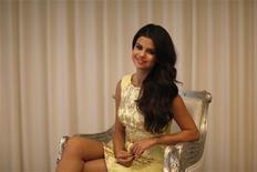 "Actress and singer Selena Gomez poses for a portrait while promoting her movie ""Spring Breakers"" in Los Angeles, California March 16, 2013. REUTERS/Mario Anzuoni"