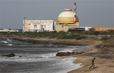 A policeman walks on a beach near Kudankulam nuclear power project in the southern Indian state of Tamil Nadu September 13, 2012. REUTERS/Adnan Abidi