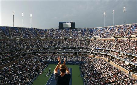 A fan stands up to applaud during the match between Rafael Nadal of Spain and Novak Djokovic of Serbia in the men's final at the U.S. Open tennis tournament in New York September 13, 2010. REUTERS/Jessica Rinaldi