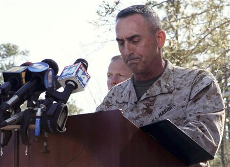 Brig. Gen. James W. Lukeman, 2nd Marine Division commanding general, offers his remarks and condolences outside the main gate of Marine Corps Base Camp Lejeune, North Carolina in this March 19, 2013 handout photo courtesy of the U.S. Marines. REUTERS/U.S. Marine Corps/Lance Cpl. Jackeline Perez River/Handout