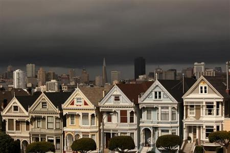 A row of Victorian homes known locally as the ''Painted Ladies'' glow in the early evening sun following a rain shower in San Francisco, California May 3, 2012. REUTERS/Robert Galbraith