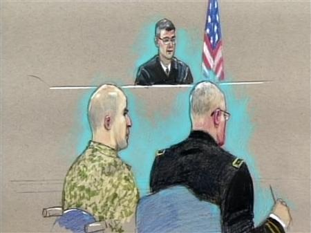 U.S. Army Major Nidal Malik Hasan (L) appears before the Fort Hood Chief Circuit Judge Colonel Gregory Gross (C-rear) with a military lawyer (R) during an arraignment as seen in this courtroom sketch, July 20, 2011. REUTERS/Pat Lopez/Pool