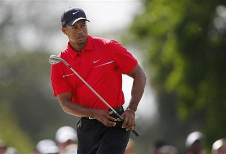 Tiger Woods watches his chip shot on the 6th hole during final round play in the 2013 WGC-Cadillac Championship PGA golf tournament in Doral, Florida March 10, 2013. REUTERS/Andrew Innerarity