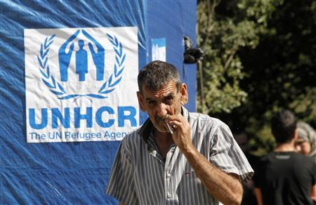 A Syrian refugee smokes during the visit of U.N. High Commissioner for Refugees (UNHCR) Antonio Guterres in Ketermaya village in the Chouf mountains March 14, 2013. REUTERS/Ali Hashisho
